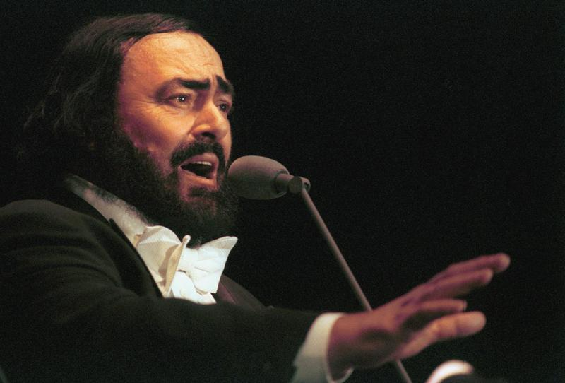 Italian tenor Luciano Pavarotti performs during a concert in Bucharest Aug. 11, 1999. The concert took place on the day of the last total solar eclipse of the millennium.