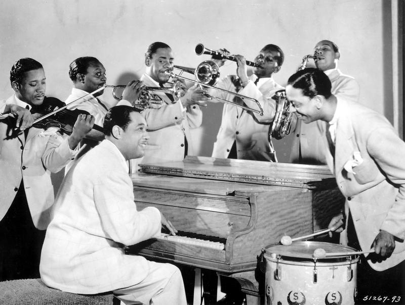 Duke Ellington (seated) and members of his famous Ellington Orchestra.