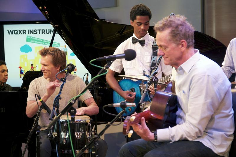 The Bacon Brothers play with students from Washington Heights Expeditionary Learning School (WHEELS), which was one of the New York public schools to receive instruments from the Instrument Drive.