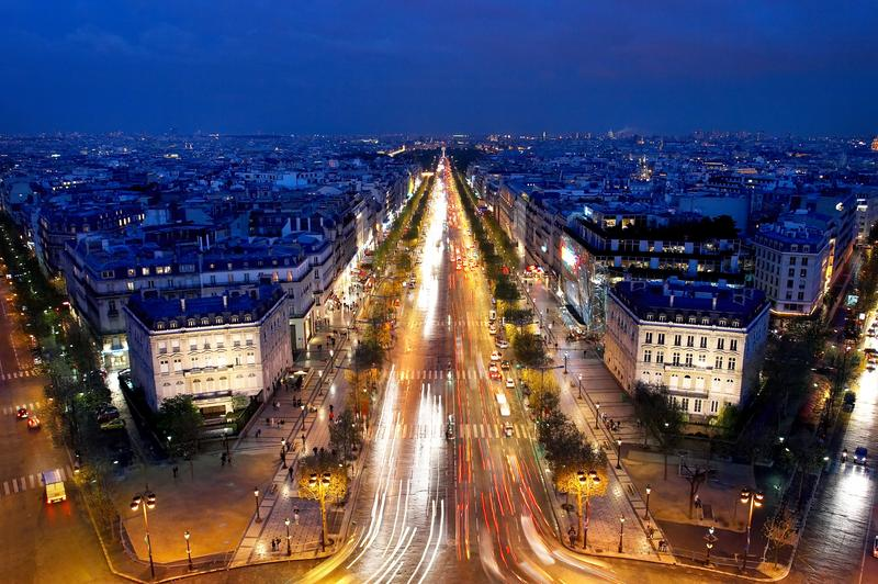 The Champs-Elysées in Paris at night.