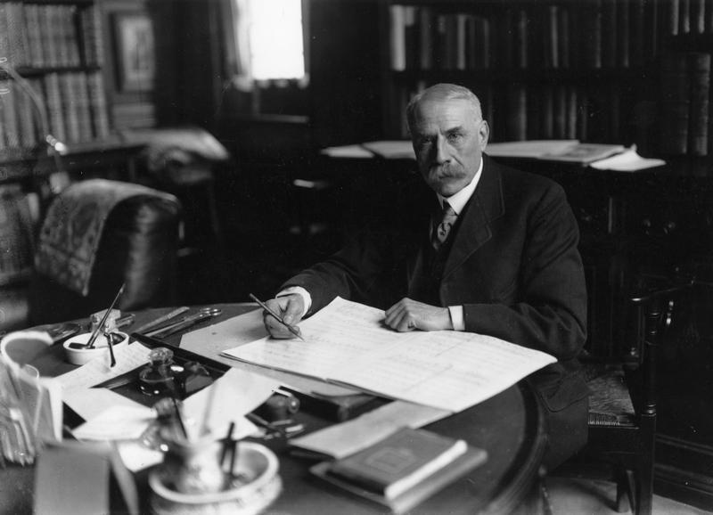 British composer Edward Elgar at work composing around 1919.