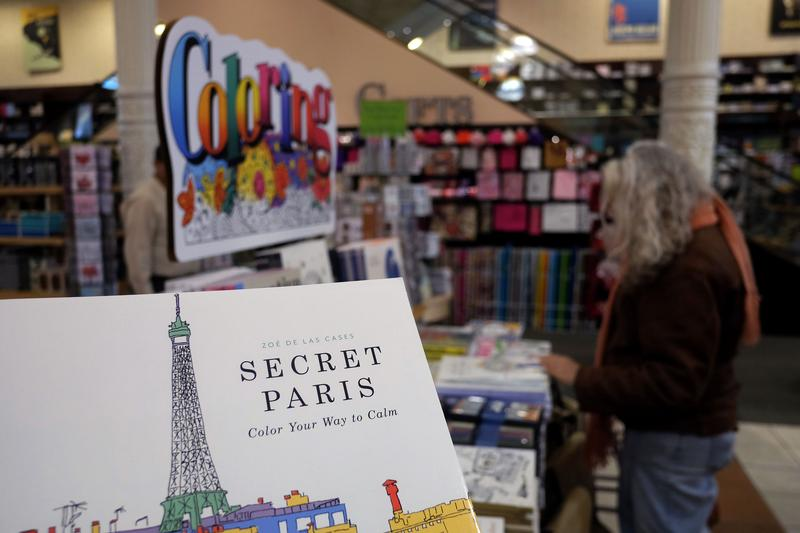 A Woman Checks Out Coloring Pencils Next To Adult Books At Barnes And Nobel Store In New York Jewel Samad Getty