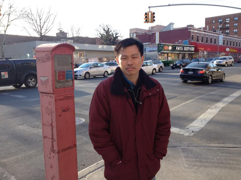 Hsi Pei Liao At An Intersection In Flushing Behind Him Is The Street Where