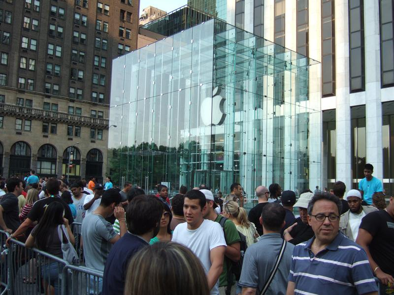 Apple aficionados wait in line around the Apple Store on Fifth Avenue in New York City in anticipation of a new product.