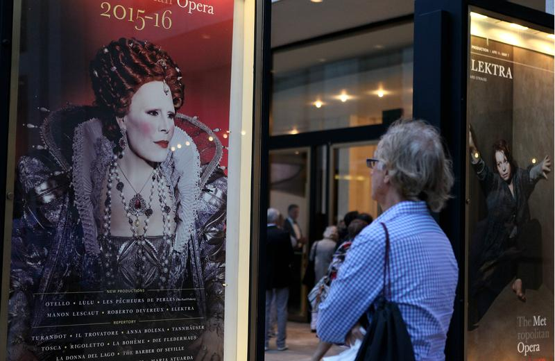 A patron arrives at the Metropolitan Opera on opening night