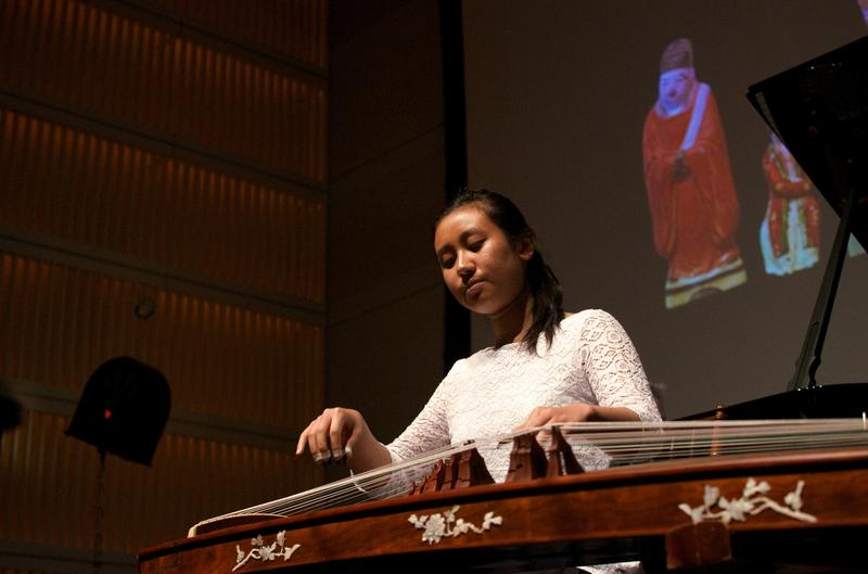 Guzheng player Rujia Teng performs 'The Eternal Sorrow of Lin'An' by Zhanhao He with projected artwork.