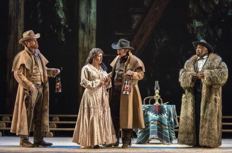 New York City Opera production of 'La Fanciulla del West' (The Girl of the Golden West). L-R: Christopher Job, Ashby; Kristin Sampson, Minnie; Alexander Birch Elliott, Sonora; Kevin Short, Jack Rance.