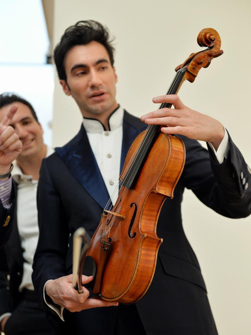 David Aaron Carpenter, the violist, holds the Macdonald viola by Antonio Stradivari at Sotheby's.