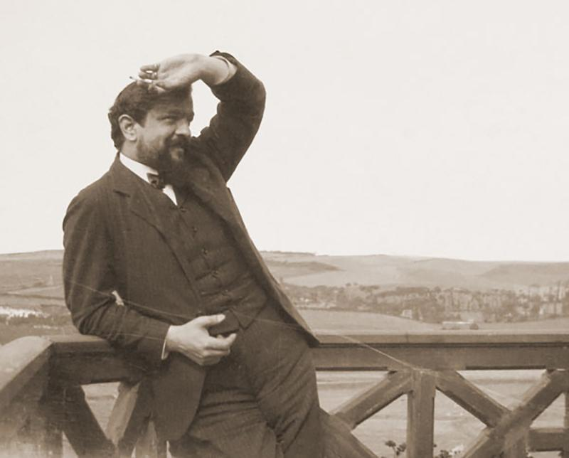 Claude Debussy, enjoying some nice weather.