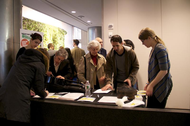 People make donations to the WQXR Instrument Drive at the David Rubenstein Atrium at Lincoln Center.
