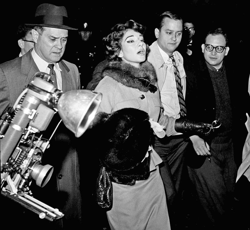 Maria Callas takes reporter questions upon landing at LaGuardia airport Oct. 29, 1959.