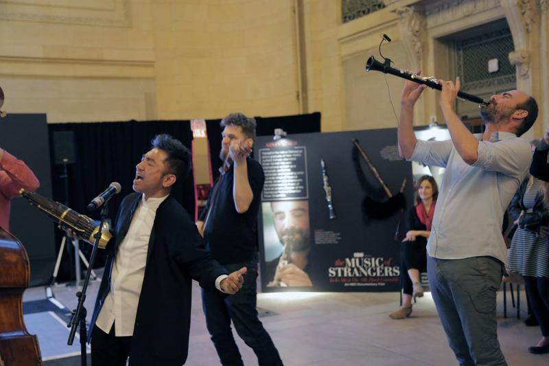 """From left to right: Vocalist and sheng player Wu Tong, violinist Johnny Gandelsman and clarinetist Kinan Azmeh perform at a promotional event for the upcoming documentary """"The Music of Strangers."""""""