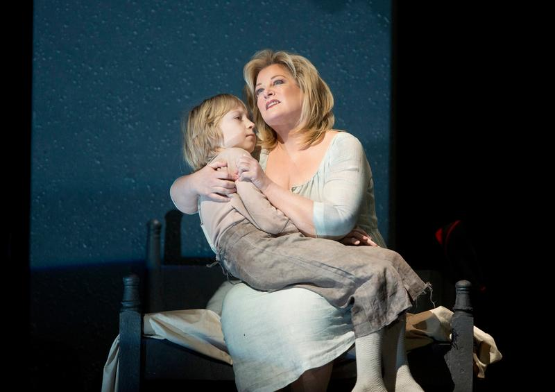 "Anthony Reznikovsky as Marie's child and Deborah Voigt as Marie in Berg's ""Wozzeck."""