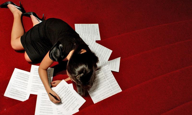 Young girl writing music