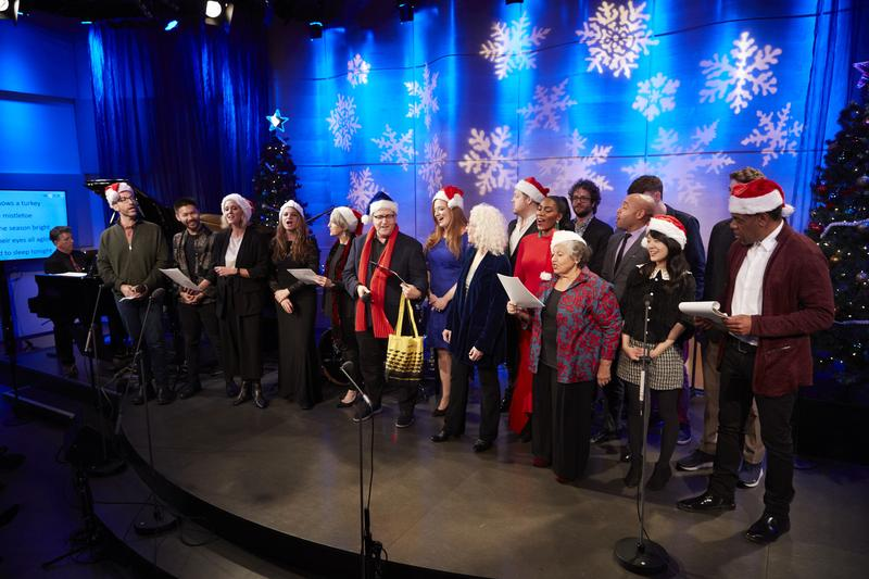 WQXR's hosts and performers onstage during a sing-along at the 2018 Christmas Party in the Greene Space