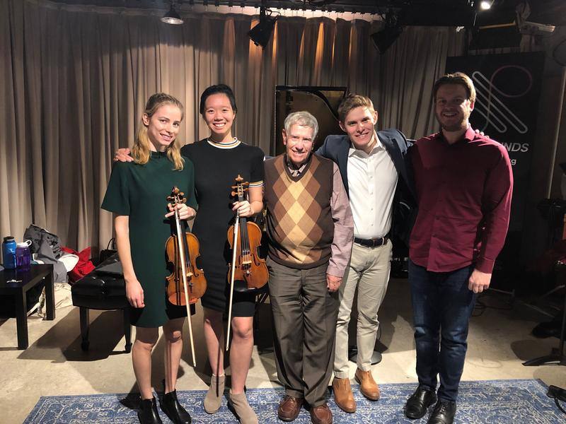 Robert Sherman with violinists Mariella Haubs, Jocelyn Zhu, and pianist Matthew Maimone of Concerts for Compassion, along with composer Jesse Brault.