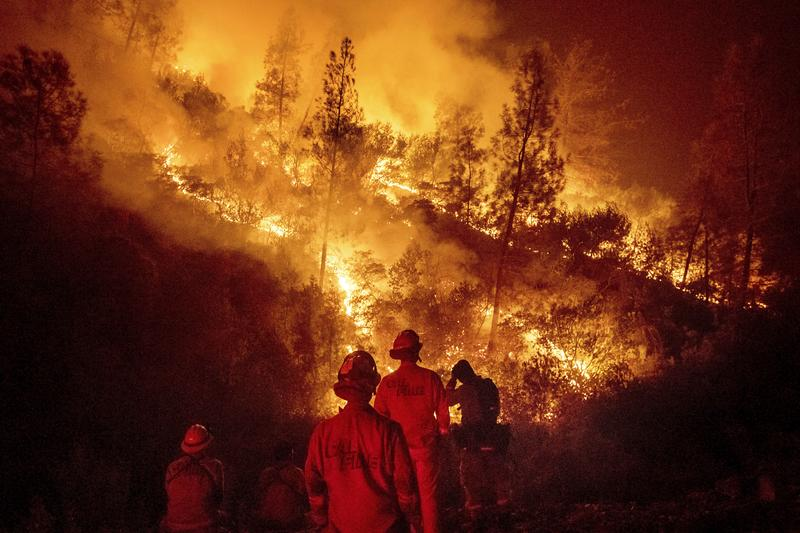 n this Aug. 7, 2018 file photo, firefighters monitor a backfire while battling the Ranch Fire, part of the Mendocino Complex Fire near Ladoga, Calif.  ( Noah Berger / Associated Press )