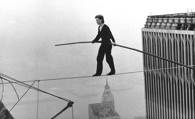 In this Aug. 7, 1974 file photo, Philippe Petit, a French high wire artist, walks across a tightrope suspended between the World Trade Center's Twin Towers in New York.
