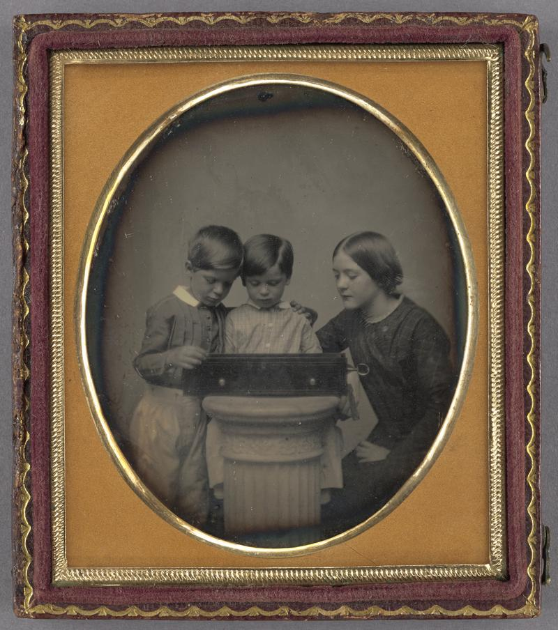 Unknown maker, American [Portrait of Two Children and Their Mother Viewing a Music Box], about 1851, Daguerreotype 84.XT.1578.1