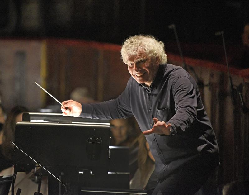 "Sir Simon Rattle conducting a rehearsal of Strauss's ""Der Rosenkavalier."""