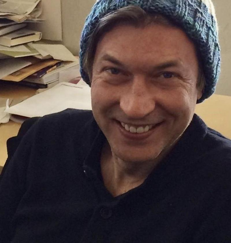 Richard Hake in the WNYC newsroom, rocking a hat knitted for him by editor Karen Frillmann.