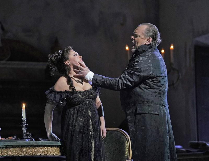 "Anna Netrebko in the title role and Michael Volle as Scarpia in Puccini's ""Tosca."""
