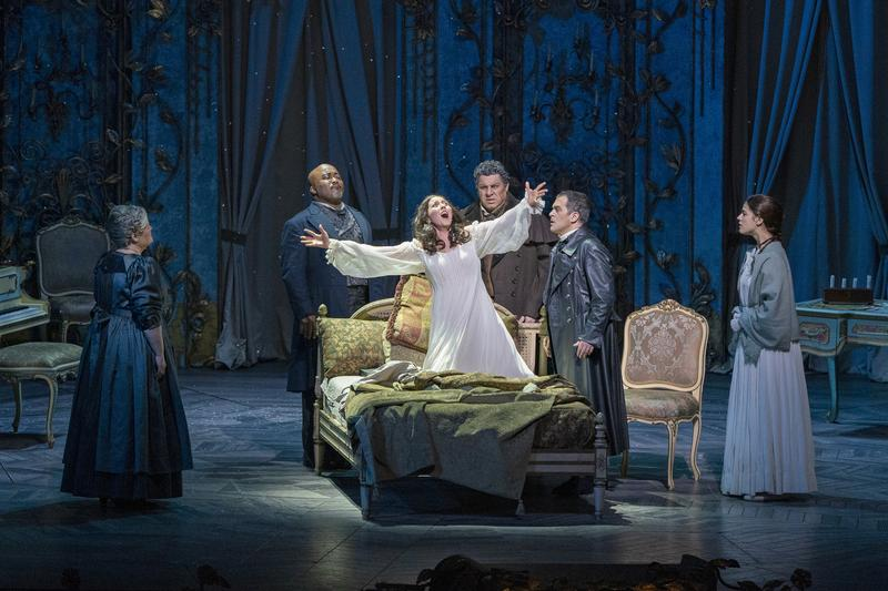 """Maria Zifchak as Annina, Kevin Short as Dr. Grenvil, Lisette Oropesa as Violetta, Luca Salsi as Germont, Piero Pretti as Alfredo, and Kendall Cafaro as Germont's daughter in Verdi's """"La Traviata."""""""