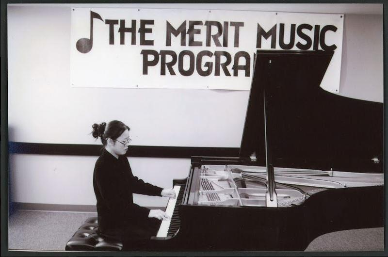 Pianist Tereza Lee performing at the piano at the Music Merit Program during the 2000s