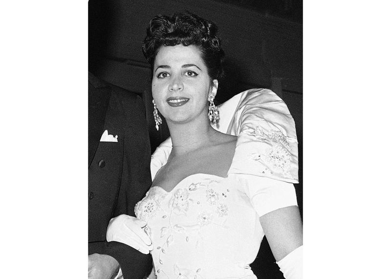 """This Oct. 26, 1959 photo shows American mezzo-soprano Rosalind Elias arriving at the Metropolitan Opera House in New York to attend a performance of Verdi's """"Il Trovatore."""""""