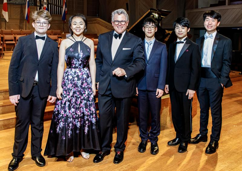 The top winners of this year's Hilton Head Piano Competition with Music Director John Morris Russell
