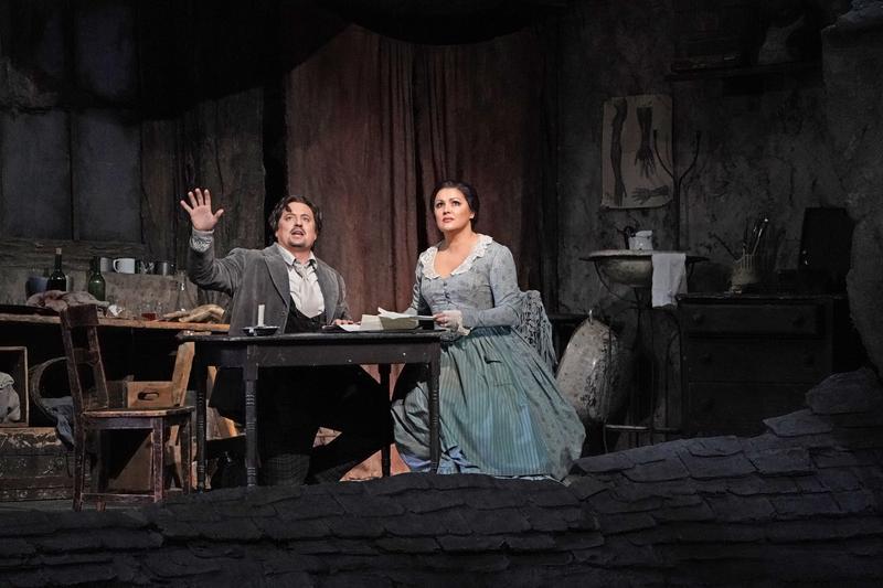 "Mathew Polenzani as Rodolfo and Anna Netrebko as Mimì in Act 1 of Puccini's ""La Bohème."""