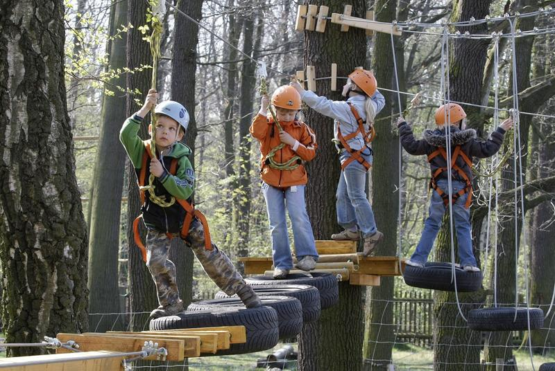 Jason, left, and other kids have fun as they try out a new adventure playground in Moritzburg, some 20 miles north of Dresden, Germany, Thursday, April 24, 2008.