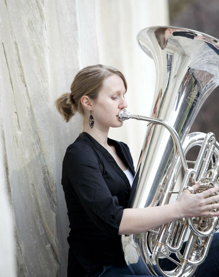 Orchestras and her playing Orchestra Tuba Player