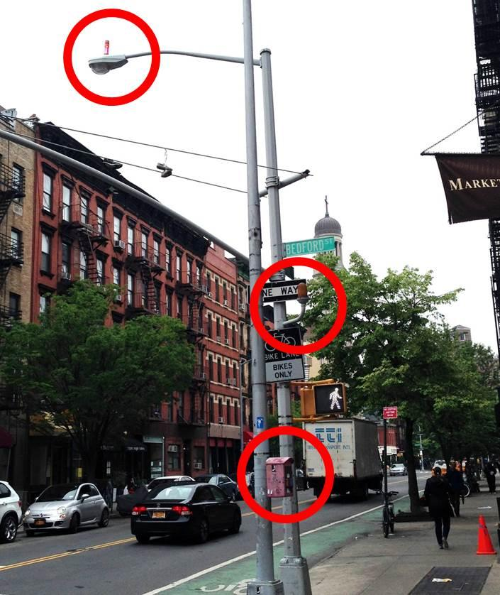 Lighting Nyc: Those Little Orange Discs On Top Of Street Lights? They're