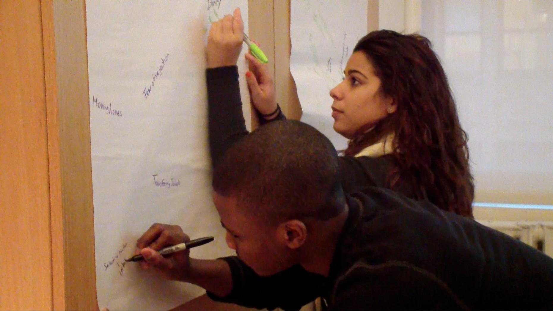Rookies Valerie and Emmanuel during a brainstorming session