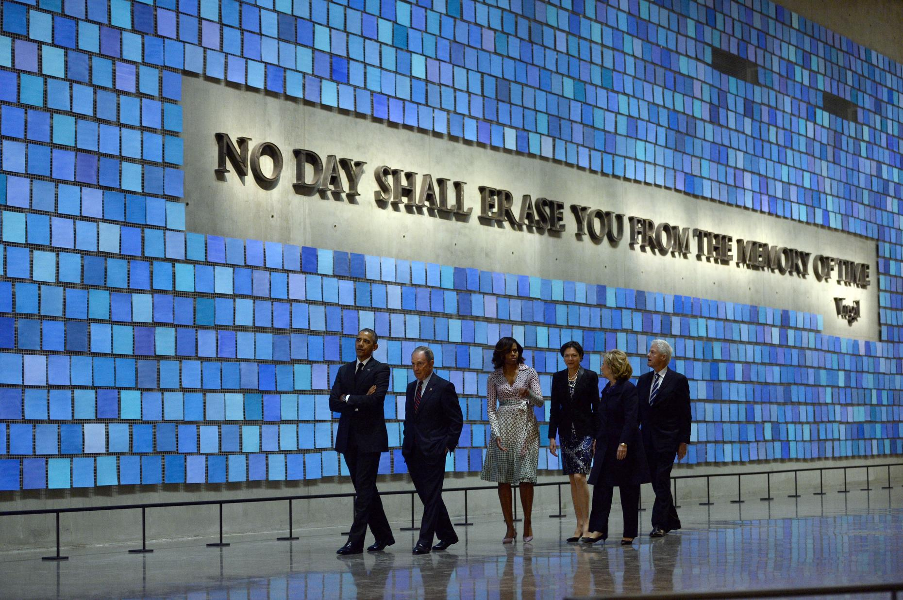 President Barack Obama, Michael Bloomberg, Michelle Obama, Hillary Clinton, and Bill Clinton tour the National September 11 Memorial & Museum. (Jewel Samad/AFP)