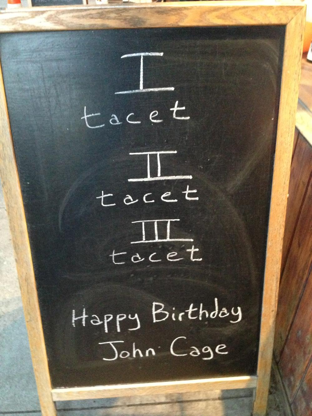 A Park Slope wine shop had an especially clever birthday wish for avant-garde composer John Cage, who would've turned 101 yesterday.