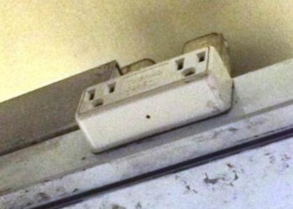 Pin hole at bottom of plug adapter mounted to cable channel located above MVM (contains camera) (NYPD)