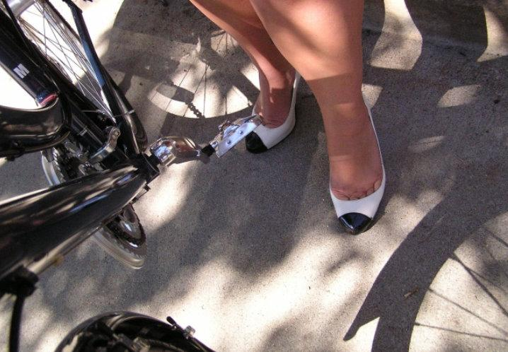 Female biker's feet in heels
