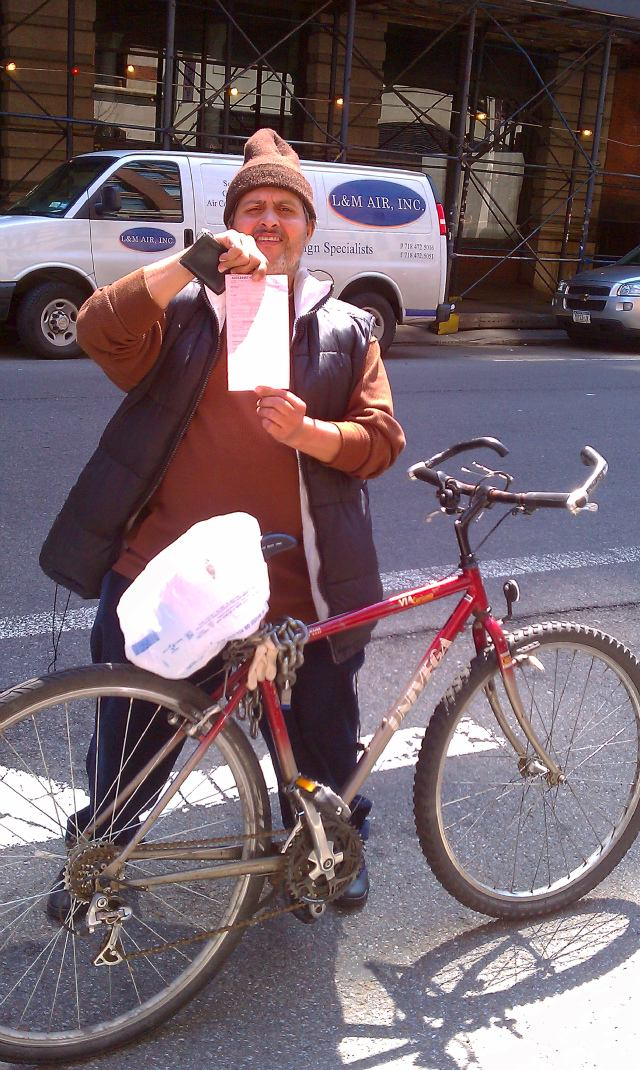 Victor Velasquez showing his ticket for not riding in the Lafayette St bike lane (Photo: Alex Goldmark)
