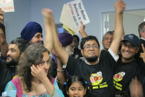 Drivers rejoice & head of TWA Bhairavi Desai is moved to tears after the Commission's vote (photo by Kathleen Horan/WNC)