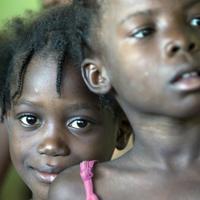 Children wait in line for medical care in Haiti