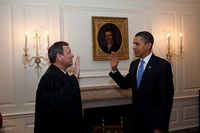 President Barack Obama is given the Oath of Office for a second time by Chief Justice John G. Roberts, Jr. in the Map Room of the White House, Jan. 21, 2009.