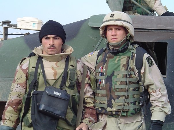 Andrew Roberts, right, in Iraq.