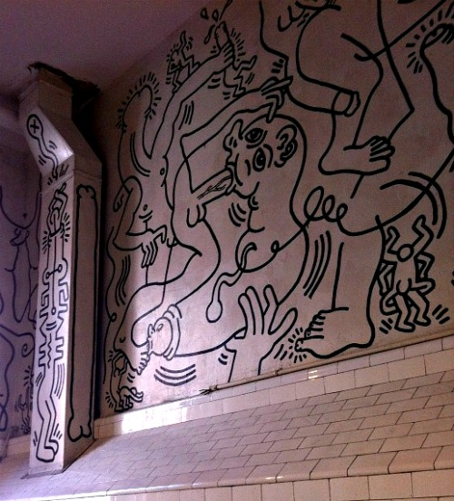 A restoration of 'Once Upon a Time,' Keith Haring's 1989 mural in the Center's men's bathroom, is on display through the end of March.