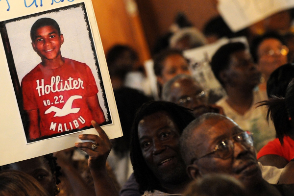 Civil rights leaders and residents of the city of Sanford attend to a town hall meeting to discuss the death of an unarmed black teen Trayvon Martin
