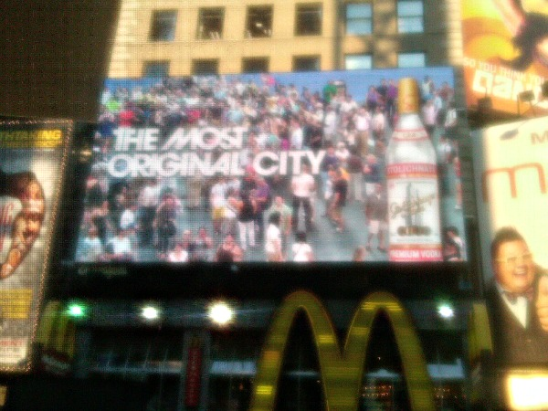 The choir makes a billboard appearance in Times Square.