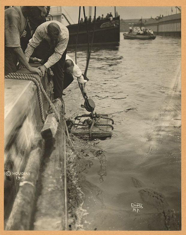 Houdini lowered into NY Harbor in 1912