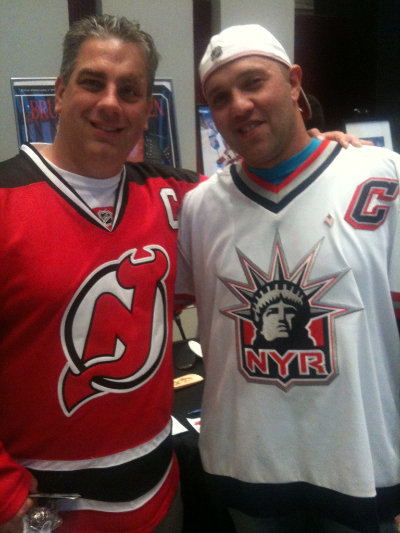 Michael Vicich (left) and Ilya Kravetskiy live in New Jersey, but can't agree on a hockey team