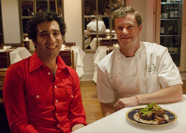 Artist Michael Rakowitz and Chef Kevin Lasko with a plate full of 'Spoils.' (Photo by Christopher Kissock, Courtesy of Creative Time)
